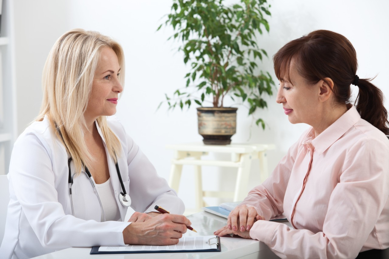 woman talking to a doctor about natural menopause treatments