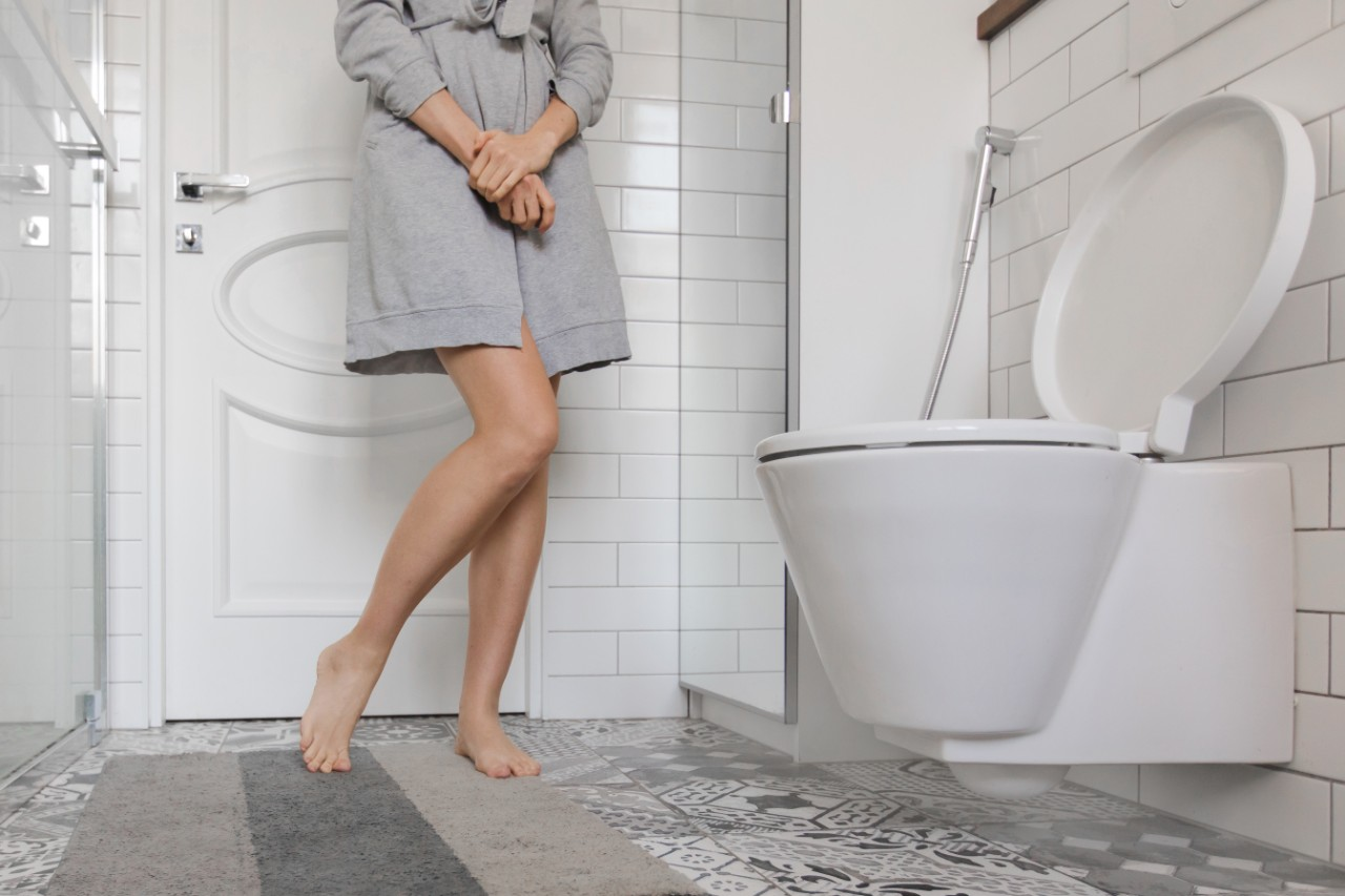 woman rushing to the toilet