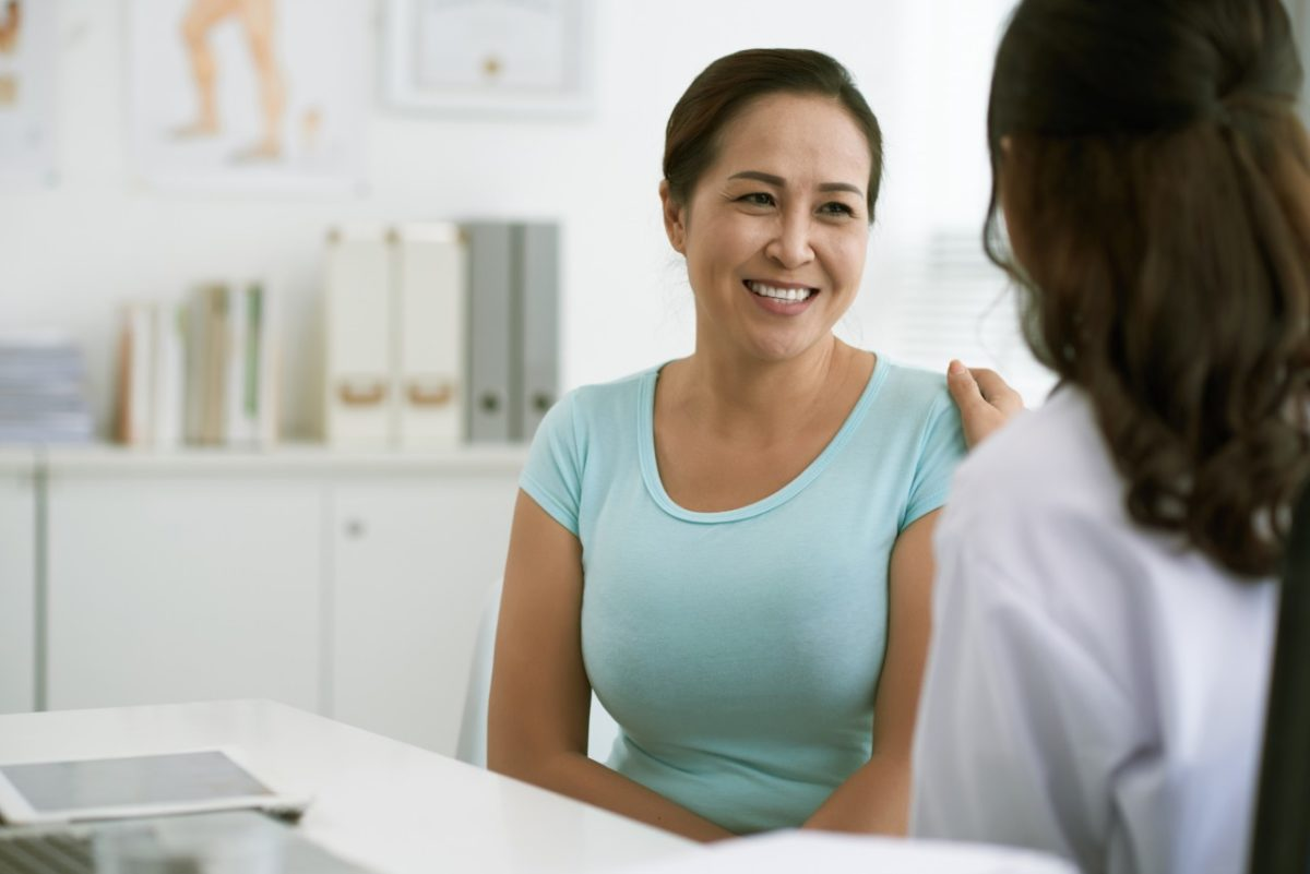 doctor talking to patient about abnormal bleeding