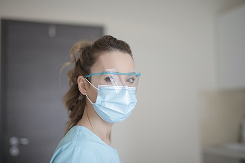 Nurse wearing a mask and face shield