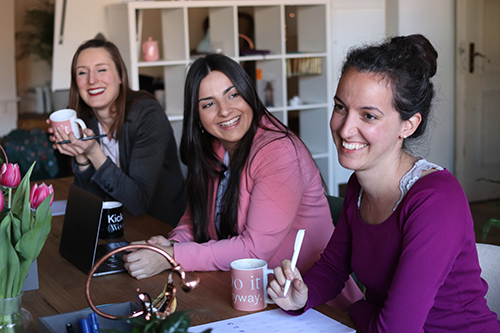 Smiling women with coffee at a table